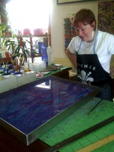 Tina looking at the design in the colla (glue)