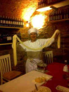 Lisa with pasta stretched and ready to make ravioli