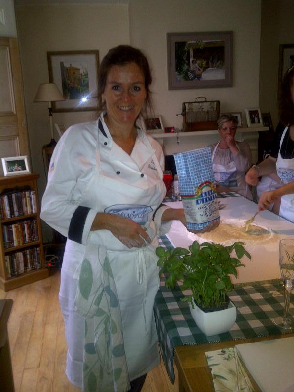 Ever smilely Lisa explains about fresh basil for the bruschetta