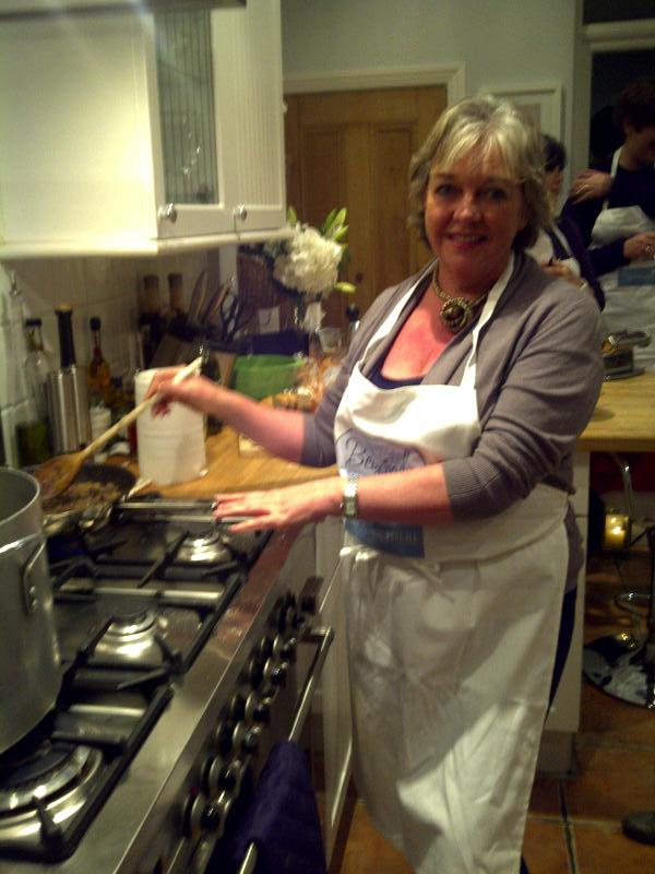 Irene stirring the stock for the pasta sauce